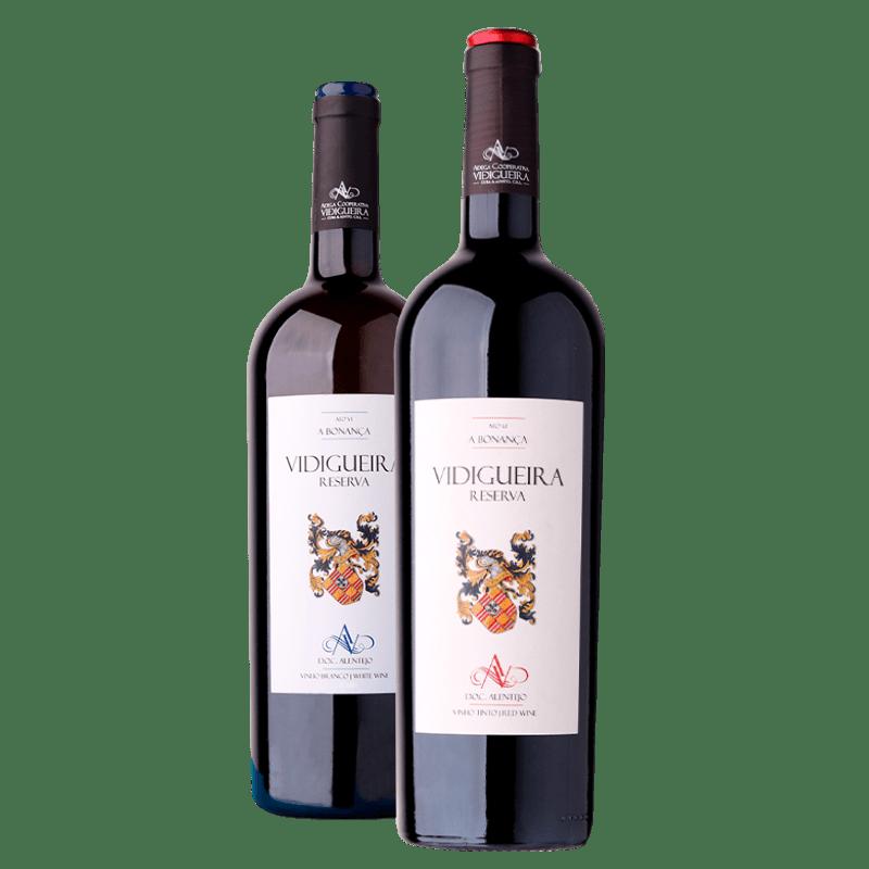 Duas garrafas de vinho. Em primeiro plano Vidigueira Reserva Tinto e em segundo plano Vidigueira Reserva Branco. Vinhos da Adega Cooperativa Cuba e Alvito